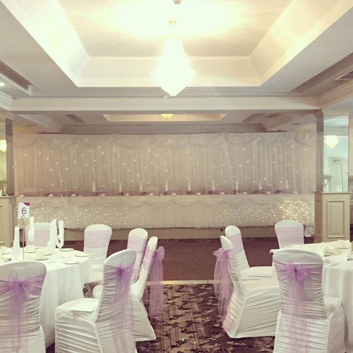 Oh pretty Wedding decor with lots of twinkling lights, chair...