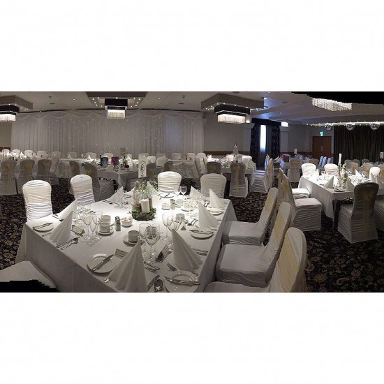 A wedding set up in the Beechlawn Hotel #chaircovers #backdrop #toptableskirt #venuestyling